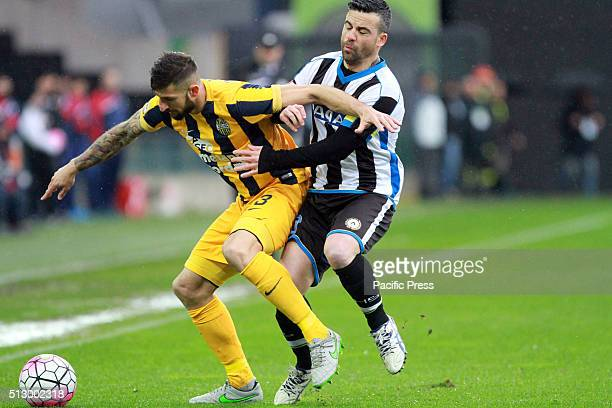 Udinese's forward Antonio Di Natale vies with Hellas Verona's defender Eros Pisano during the Italian Serie A football match between Udinese Calcio v...