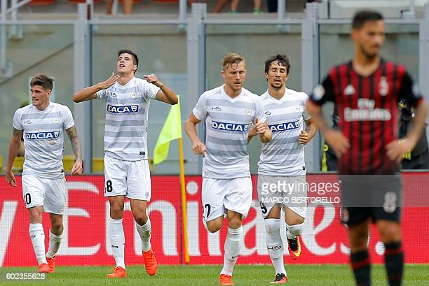 Udinese's forward Stipe Perica from Croatia celebrates after scoring a goal during the Italian Serie A football match AC Milan vs Udinese on...