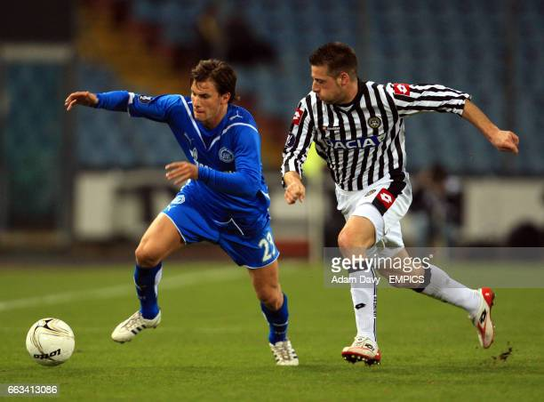 Udinese's Giovanni Pasquale and Zenit St Petersburg's Huszti battle for the ball