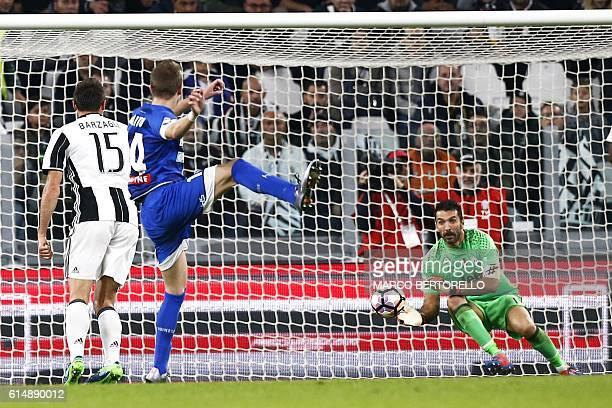 Udinese's midfielder Jakub Jankto of Czech Republic scores against Juventus goalkeeper Gianluigi Buffon during the Italian Serie A football match...