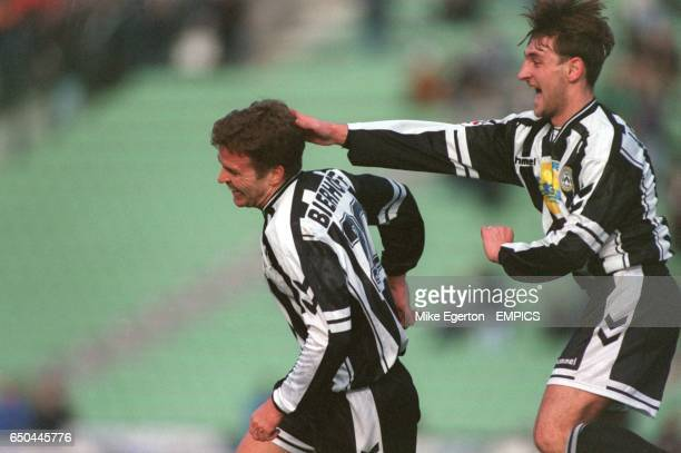 Udinese's Oliver Bierhoff and Tomas Locatelli celebrate during the match