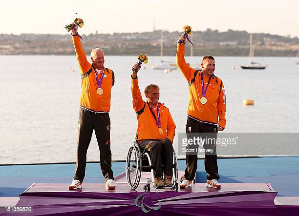 Udo Hessels Marcel van de Veen and Mischa Rossen of Netherlands celebrate winning Gold in the Three Person Keelboat on day 8 of the London 2012...