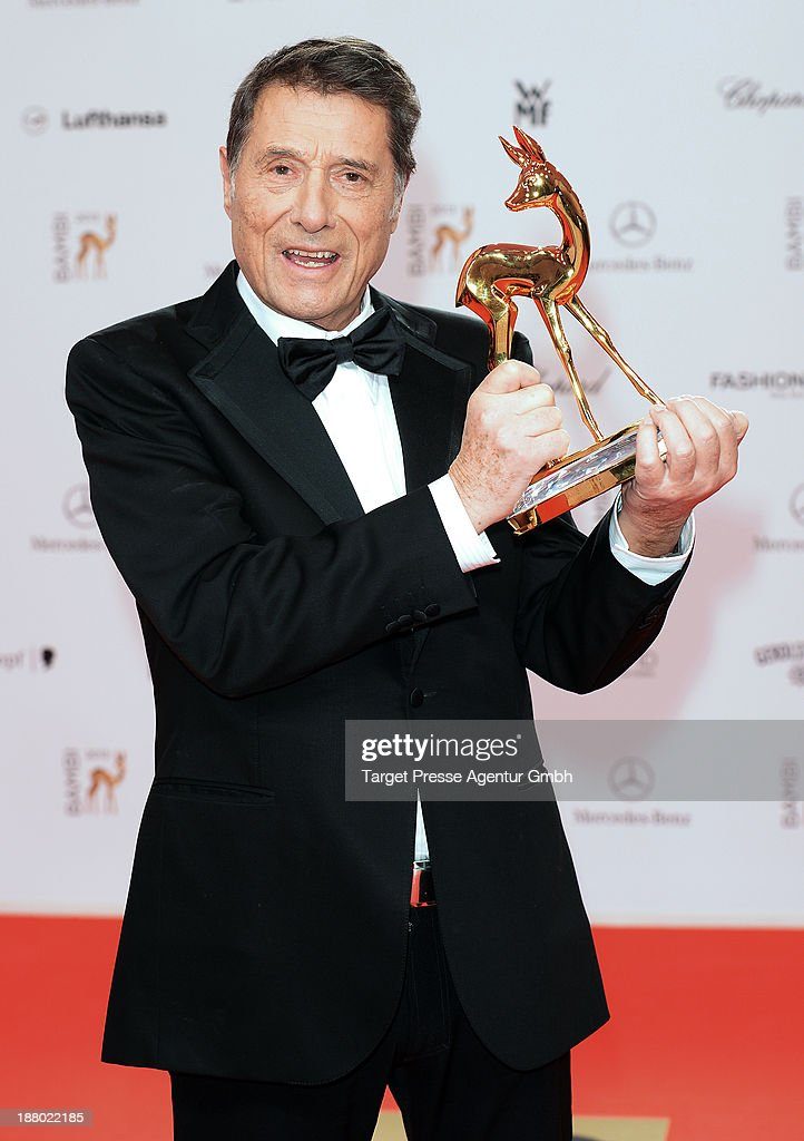 Udo Juergens poses with the Bambi for lifetime achievement at Stage Theater on November 14, 2013 in Berlin, Germany.