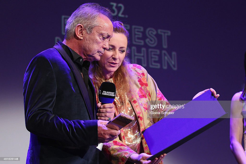 <a gi-track='captionPersonalityLinkClicked' href=/galleries/search?phrase=Udo+Kier&family=editorial&specificpeople=703878 ng-click='$event.stopPropagation()'>Udo Kier</a> and <a gi-track='captionPersonalityLinkClicked' href=/galleries/search?phrase=Diana+Iljine&family=editorial&specificpeople=9512424 ng-click='$event.stopPropagation()'>Diana Iljine</a> seen on stage at the Cine Merit Award as part of Filmfest Muenchen at Carl-Orff-Saal on June 30, 2014 in Munich, Germany.