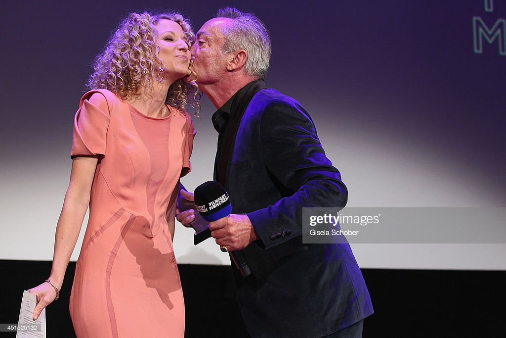 <a gi-track='captionPersonalityLinkClicked' href=/galleries/search?phrase=Udo+Kier&family=editorial&specificpeople=703878 ng-click='$event.stopPropagation()'>Udo Kier</a> kisses Aline von Drateln on stage at the Cine Merit Award as part of Filmfest Muenchen at Carl-Orff-Saal on June 30, 2014 in Munich, Germany.