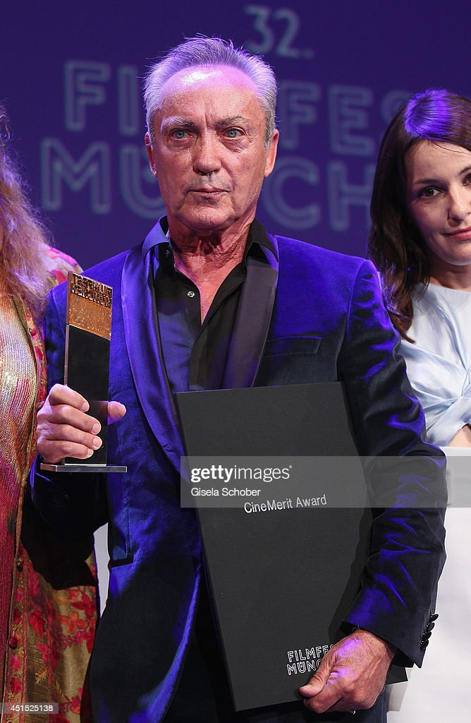 <a gi-track='captionPersonalityLinkClicked' href=/galleries/search?phrase=Udo+Kier&family=editorial&specificpeople=703878 ng-click='$event.stopPropagation()'>Udo Kier</a> poses with his award during the Cine Merit Award as part of Filmfest Muenchen at Carl-Orff-Saal on June 30, 2014 in Munich, Germany.