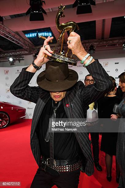 Udo Lindenberg poses with award at the Bambi Awards 2016 winners board at Stage Theater on November 17 2016 in Berlin Germany