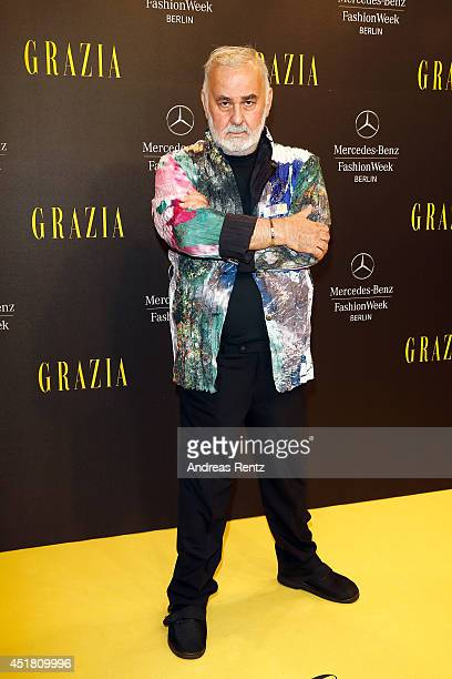 Udo Walz arrives for the Opening Night by Grazia fashion show during the MercedesBenz Fashion Week Spring/Summer 2015 at Erika Hess Eisstadion on...