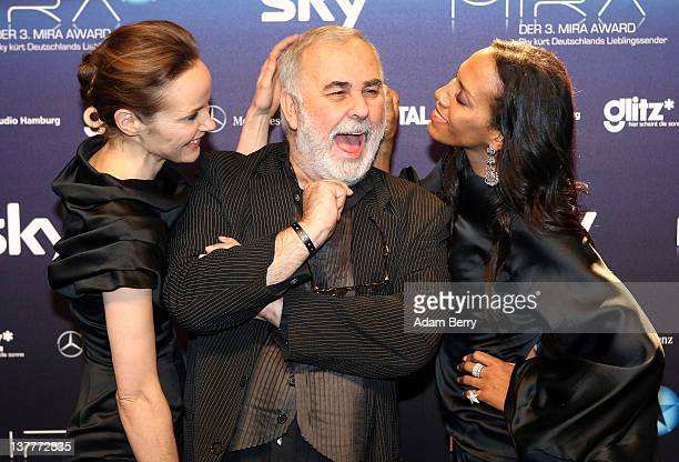 Udo Walz arrives with Jeanette Hain and Barbara Becker for the Mira Awards ceremony at eWerk on January 26 2012 in Berlin Germany The Mira Award is...