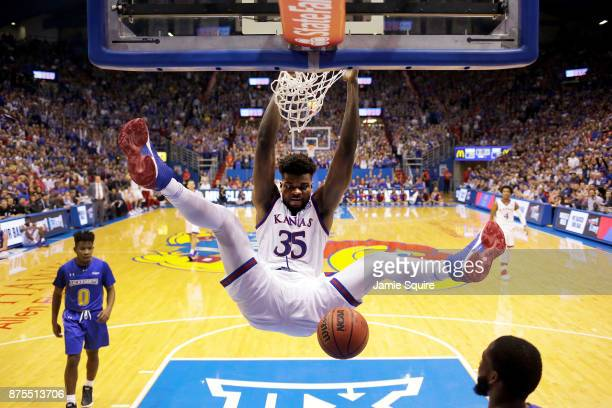 Udoka Azubuike of the Kansas Jayhawks dunks during the 1st half of the game against the South Dakota State Jackrabbits at Allen Fieldhouse on...