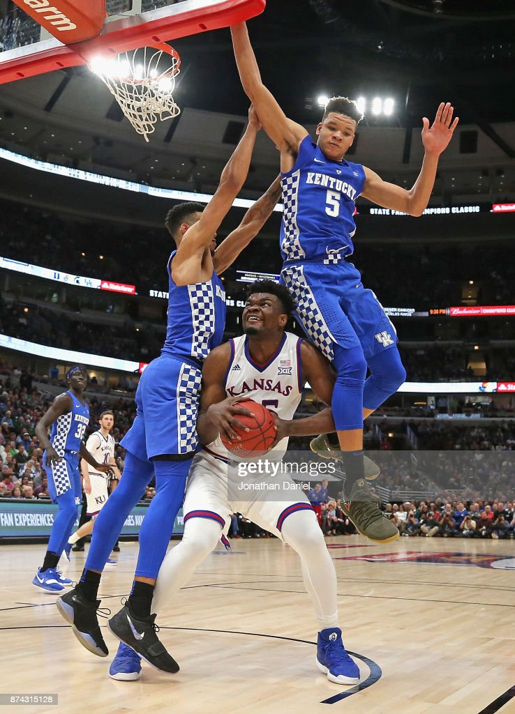 Udoka Azubuike #35 of the Kansas Jayhawks is fouled as he tries to shoot between Sacha Killeya-Jones #1 and Kevin Knox #5 of the Kentucky Wildcats during the State Farm Champions Classic at the United Center on November 14, 2017 in Chicago, Illinois.
