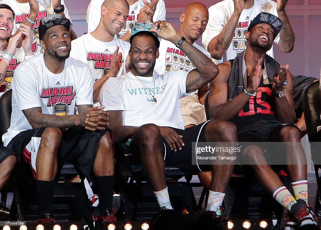 Udonis Haslem, LeBron James and Dwyane Wade of the Miami Heat attend their NBA Championship victory rally at the AmericanAirlines Arena on June 24, 2013 in Miami, Florida. The Miami Heat defeated the San Antonio Spurs in the NBA Finals.