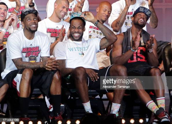 Udonis Haslem LeBron James and Dwyane Wade of the Miami Heat attend their NBA Championship victory rally at the AmericanAirlines Arena on June 24...