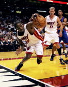 Udonis Haslem of the Miami Heat chases a loose ball in the first half against the New York Knicks on November 28 2005 at American Airlines Arena in...
