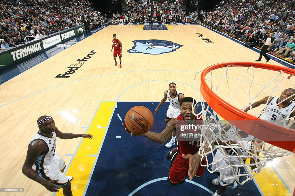 <a gi-track='captionPersonalityLinkClicked' href=/galleries/search?phrase=Udonis+Haslem&family=editorial&specificpeople=201748 ng-click='$event.stopPropagation()'>Udonis Haslem</a> #40 of the Miami Heat drives to the basket against the Memphis Grizzlies on November 11, 2012 at FedExForum in Memphis, Tennessee.