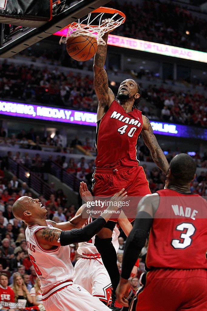 <a gi-track='captionPersonalityLinkClicked' href=/galleries/search?phrase=Udonis+Haslem&family=editorial&specificpeople=201748 ng-click='$event.stopPropagation()'>Udonis Haslem</a> #40 of the Miami Heat dunks against <a gi-track='captionPersonalityLinkClicked' href=/galleries/search?phrase=Keith+Bogans&family=editorial&specificpeople=202483 ng-click='$event.stopPropagation()'>Keith Bogans</a> #6 of the Chicago Bulls in Game Two of the Eastern Conference Finals during the 2011 NBA Playoffs on May 18, 2011 at the United Center in Chicago, Illinois.