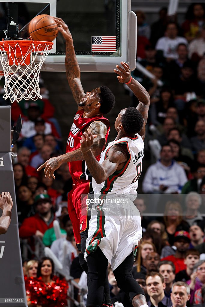 Udonis Haslem #40 of the Miami Heat dunks against Larry Sanders #8 of the Milwaukee Bucks in Game Three of the Eastern Conference Quarterfinals during the 2013 NBA Playoffs on April 25, 2013 at the BMO Harris Bradley Center in Milwaukee, Wisconsin.