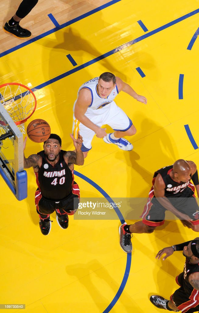 Udonis Haslem #40 of the Miami Heat goes after the rebound against Andris Biedrins #15 of the Golden State Warriors on January 16, 2013 at Oracle Arena in Oakland, California.