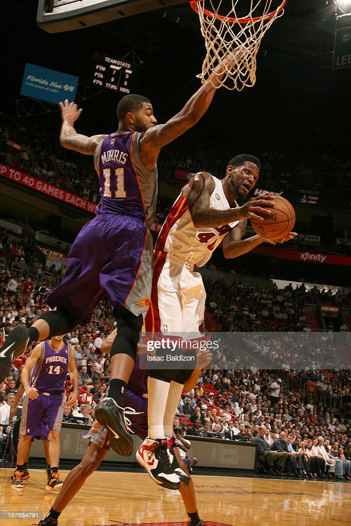 Udonis Haslem #40 of the Miami Heat grabs a rebound over Markieff Morris #11 of the Phoenix Suns during a game between the Phoenix Suns and the Miami Heat on November 5, 2012 at American Airlines Arena in Miami, Florida.