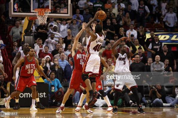 Udonis Haslem of the Miami Heat hits the gametying shot at the buzzer to send the game into overtime against the New Jersey Nets at American Airlines...