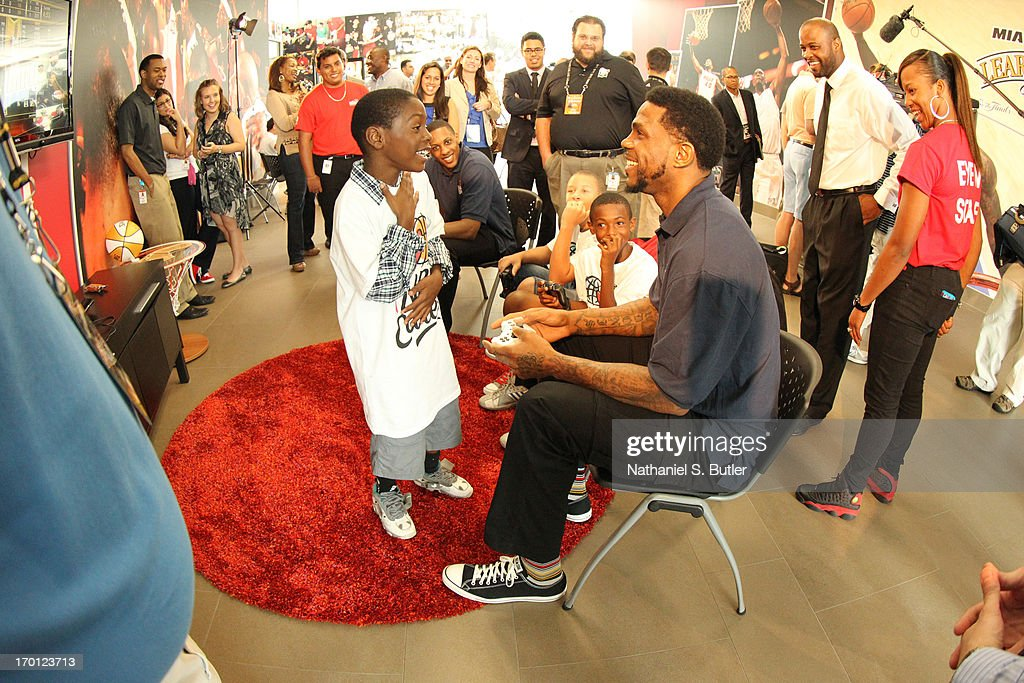 Udonis Haslem #40 of the Miami Heat interacts with a kid at the 2013 NBA Finals Legacy Project as part of the 2013 NBA Finals on June 7, 2013 at the Joe Celestin Center in Miami, Florida.