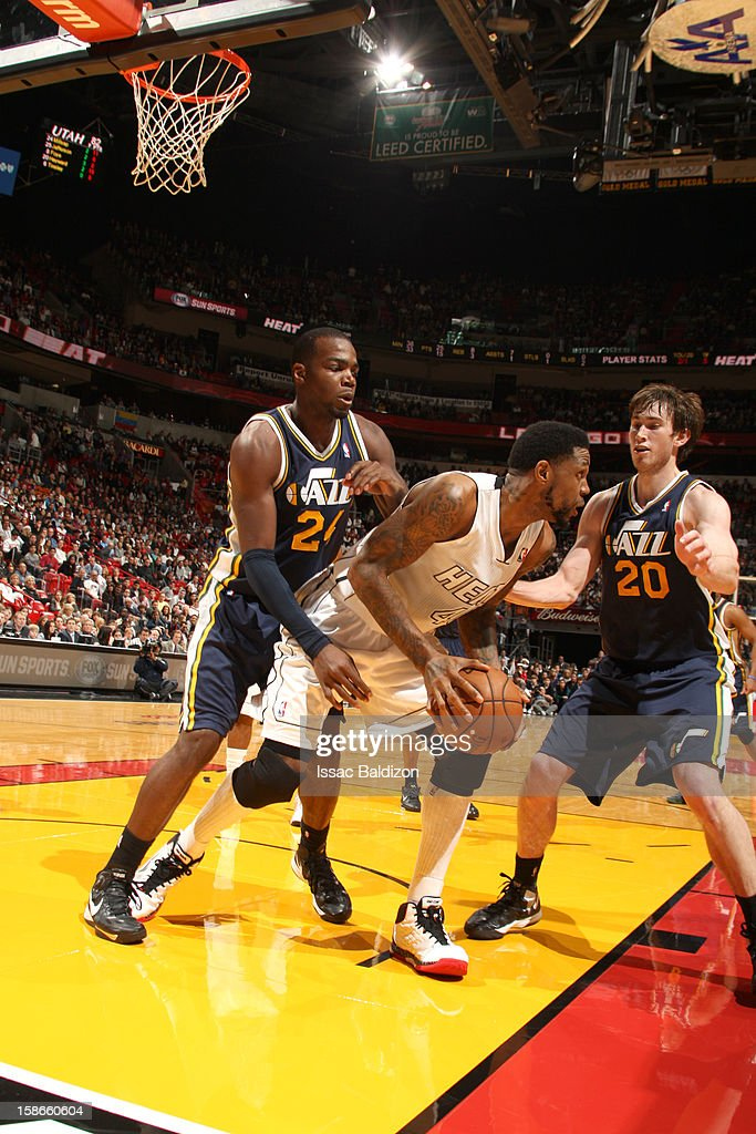 <a gi-track='captionPersonalityLinkClicked' href=/galleries/search?phrase=Udonis+Haslem&family=editorial&specificpeople=201748 ng-click='$event.stopPropagation()'>Udonis Haslem</a> #40 of the Miami Heat protects the ball from <a gi-track='captionPersonalityLinkClicked' href=/galleries/search?phrase=Paul+Millsap&family=editorial&specificpeople=880017 ng-click='$event.stopPropagation()'>Paul Millsap</a> #24 and <a gi-track='captionPersonalityLinkClicked' href=/galleries/search?phrase=Gordon+Hayward&family=editorial&specificpeople=5767271 ng-click='$event.stopPropagation()'>Gordon Hayward</a> #20 of the Utah Jazz during the game between the Utah Jazz and the Miami Heat on December 22, 2012 at American Airlines Arena in Miami, Florida.