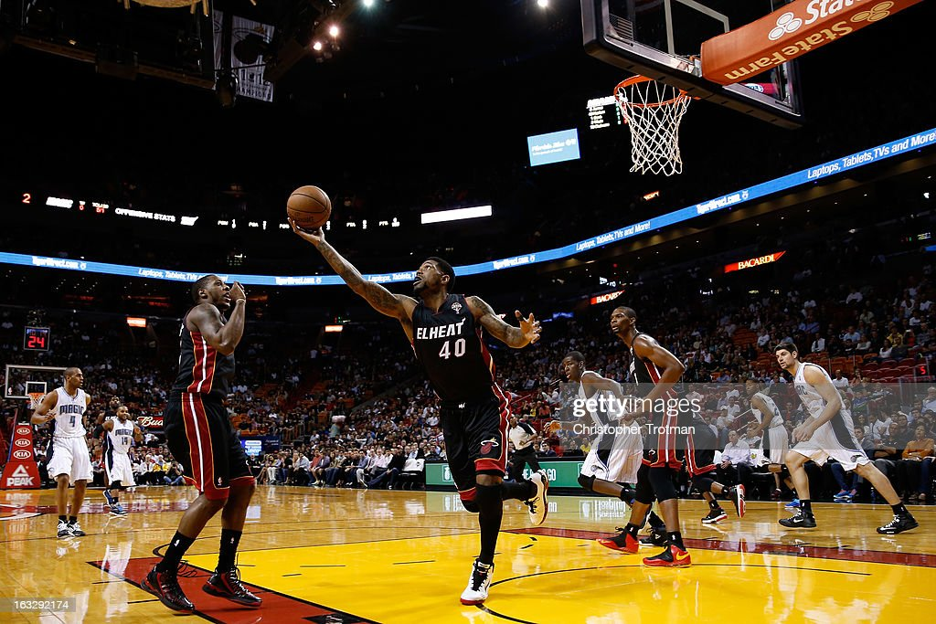 <a gi-track='captionPersonalityLinkClicked' href=/galleries/search?phrase=Udonis+Haslem&family=editorial&specificpeople=201748 ng-click='$event.stopPropagation()'>Udonis Haslem</a> #40 of the Miami Heat rebounds against the Orlando Magic at American Airlines Arena on March 6, 2013 in Miami, Florida.