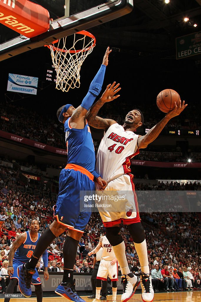 Udonis Haslem #40 of the Miami Heat shoots against Carmelo Anthony #7 of the New York Knicks on April 2, 2013 at American Airlines Arena in Miami, Florida.