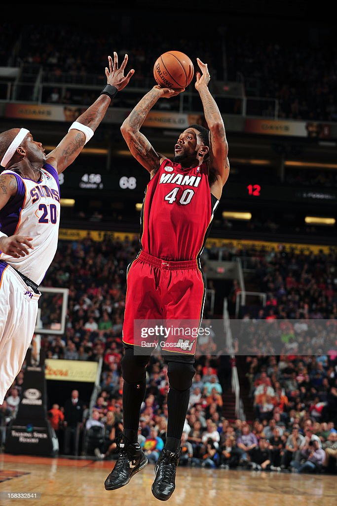 <a gi-track='captionPersonalityLinkClicked' href=/galleries/search?phrase=Udonis+Haslem&family=editorial&specificpeople=201748 ng-click='$event.stopPropagation()'>Udonis Haslem</a> #40 of the Miami Heat takes a shot over <a gi-track='captionPersonalityLinkClicked' href=/galleries/search?phrase=Jermaine+O%27Neal&family=editorial&specificpeople=201524 ng-click='$event.stopPropagation()'>Jermaine O'Neal</a> #20 of the Phoenix Suns on November 17, 2012 at U.S. Airways Center in Phoenix, Arizona.