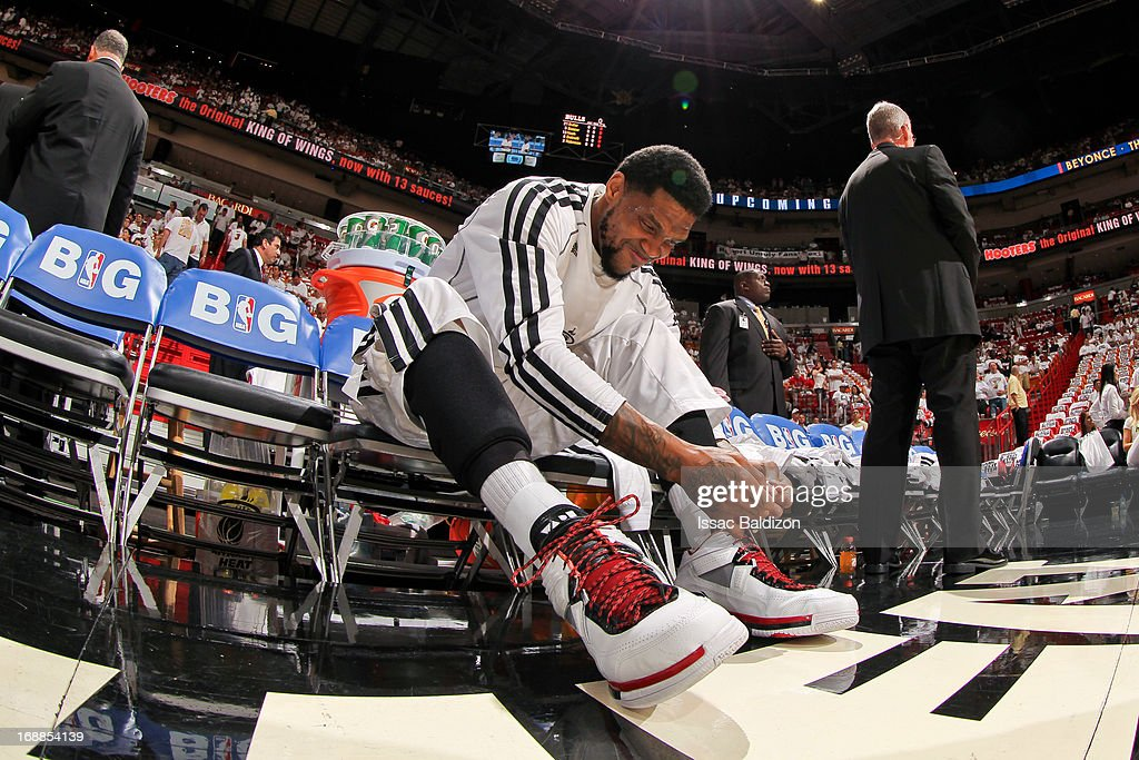 Udonis Haslem #40 of the Miami Heat ties his shoes before playing against the Chicago Bulls in Game Five of the Eastern Conference Semifinals during the 2013 NBA Playoffs on May 15, 2013 at American Airlines Arena in Miami, Florida.