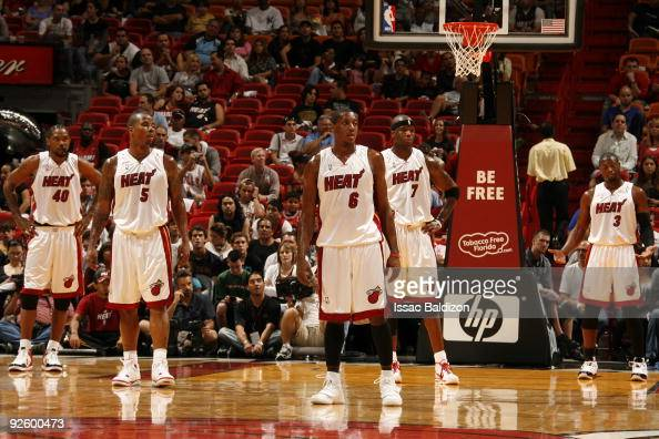 Udonis Haslem Quentin Richardson Mario Chalmers Jermaine O'Neal and Dwyane Wade of the Miami Heat take a breather against the Chicago Bulls on...