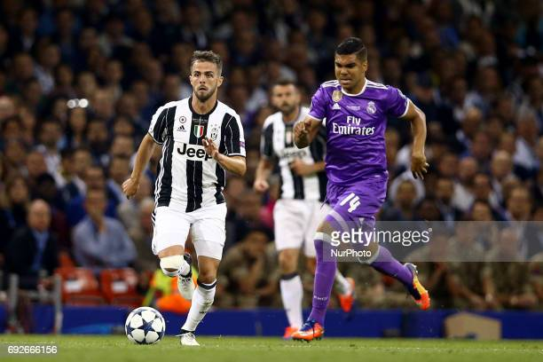 Uefa Champions League Final Juventus v Real Madrid Miralem Pjanic of Juventus and Casemiro of Real Madrid at National Stadium in Cardiff Wales on...