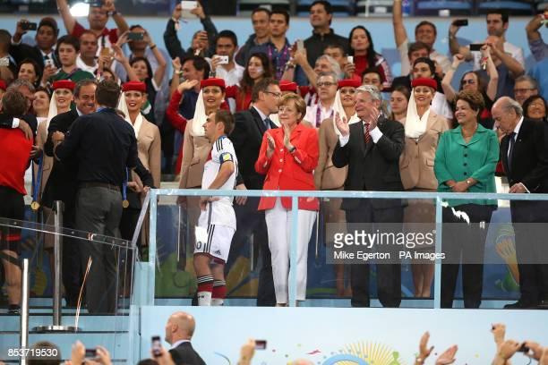 Uefa President Michel Platini greets Germany team Manager Oliver Bierhoff