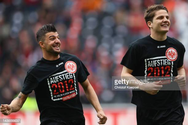 Uemit Korkmaz and Pirmin Schwegler of Frankfurt warm up prior to the Second Bundesliga match between Eintracht Frankfurt and 1860 Muenchen at...