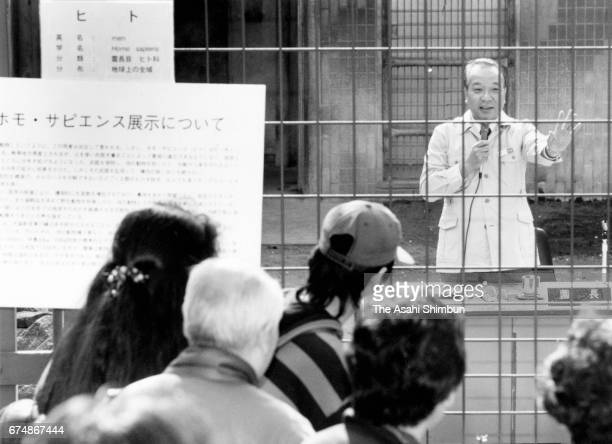 Ueno Zoo director Masaru Saito speaks in a cage at Ueno Zoo on April 1 1997 in Tokyo Japan