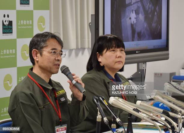 Ueno Zoological Gardens director Yutaka Fukuda answers questions while zoo official Mikako Kaneko atteds during a press conference to announce the...