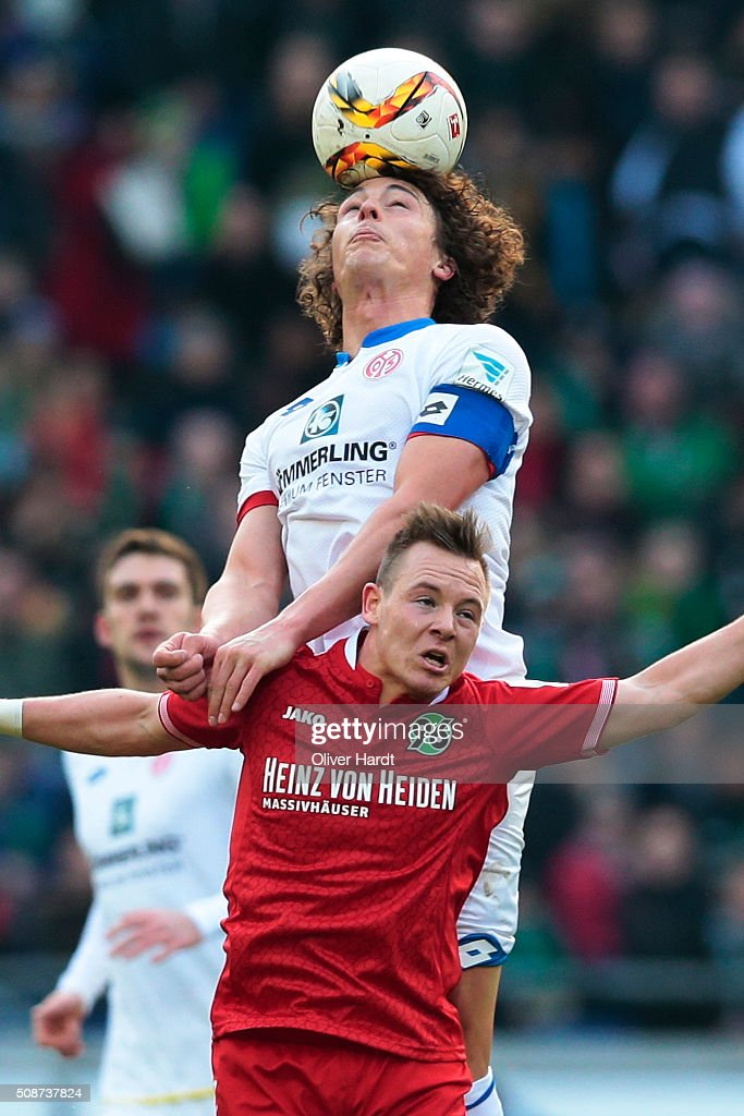 Uffe Bech (L) of Hannover and Julian Baumgartlinger (R) of Mainz compete for the ball during the first Bundesliga match between Hannover 96 and 1. FSV Mainz 05 at HDI-Arena on February 6, 2016 in Hanover, Germany.