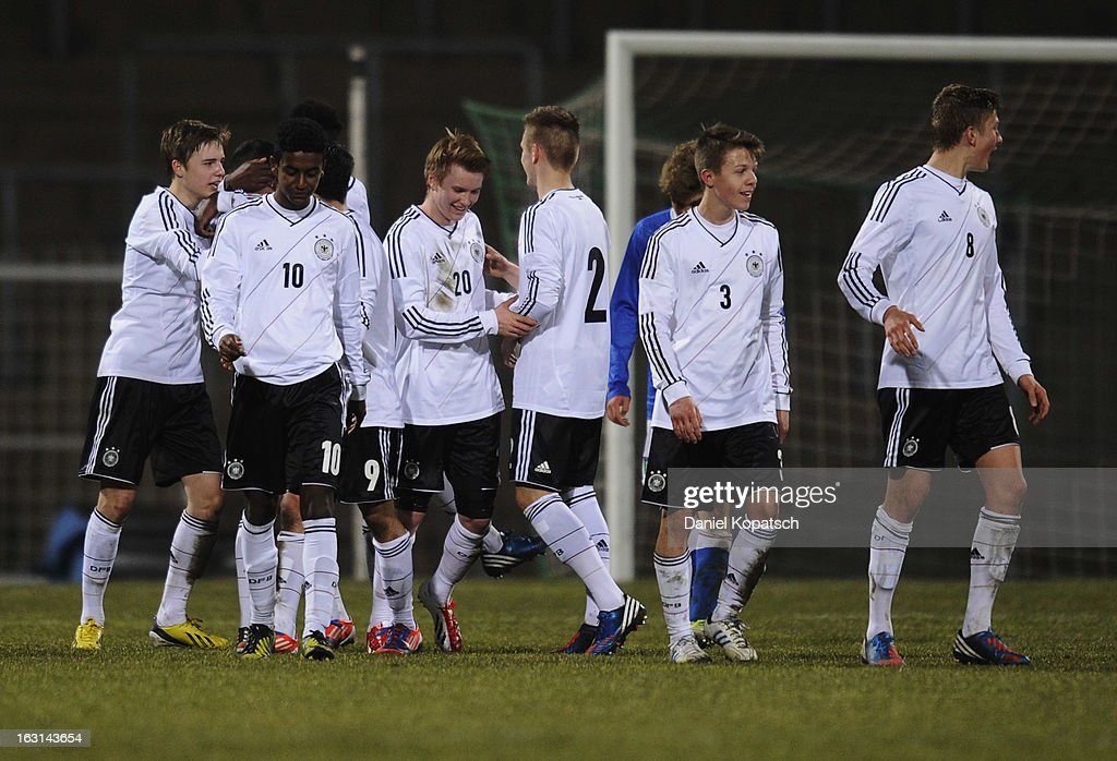 Ufuk Akyoi of Germany (hidden) celebrates his team's fifth goal with team mates during the U16 international friendly match between Germany and Italy on March 5, 2013 at Waldstadion in Homburg, Germany.