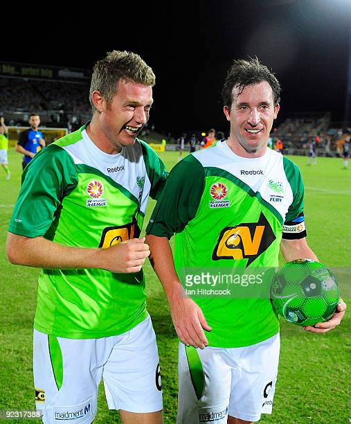 Ufuk Talay of the Fury celebrates with Robbie Fowler after the round 12 ALeague match between the North Queensland Fury and the Perth Glory at Dairy...