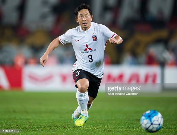 Ugajin Tomoya of Urawa Red Diamonds in in action during the AFC Champions League match between Guangzhou Evergrande and Urawa Red Diamonds on March...