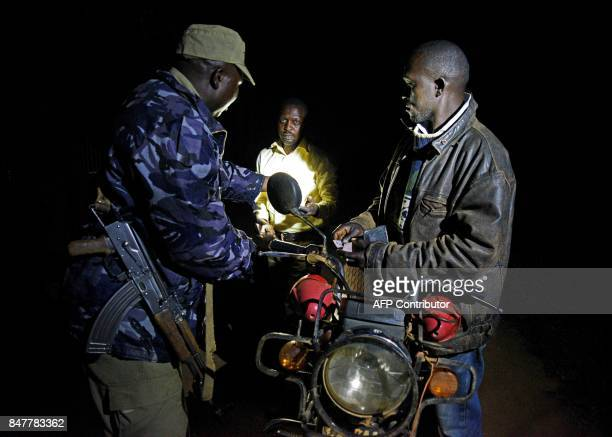 Uganda police officials and Mayumba Kumi crime preventers a community patrol team that was started by the Katabi Town Council patrol together...