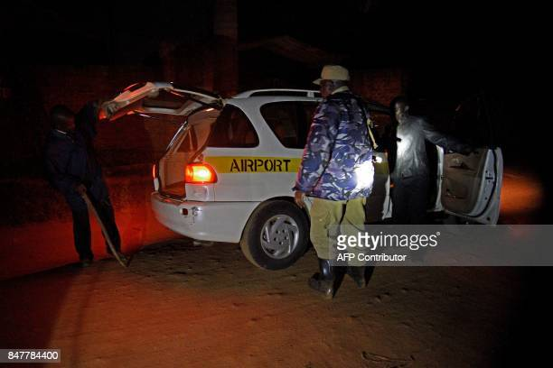 Uganda police officials and Mayumba Kumi crime preventers a community patrol team that was started by the Katabi Town Council inspect a vehicle...