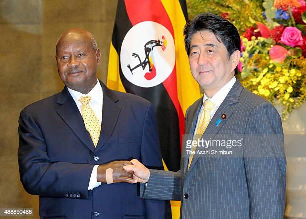 Uganda President Yoweri Museveni and Japanese Prime Minister Shinzo Abe shake hands prior to their meeting at Abe's official residence on September...