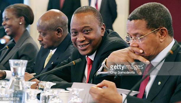 Uganda President Yoweri Museveni Kenya President Uhuru Kenyatta and Tanzania President Jakaya Kikwete participate in a roundtable discussion with...