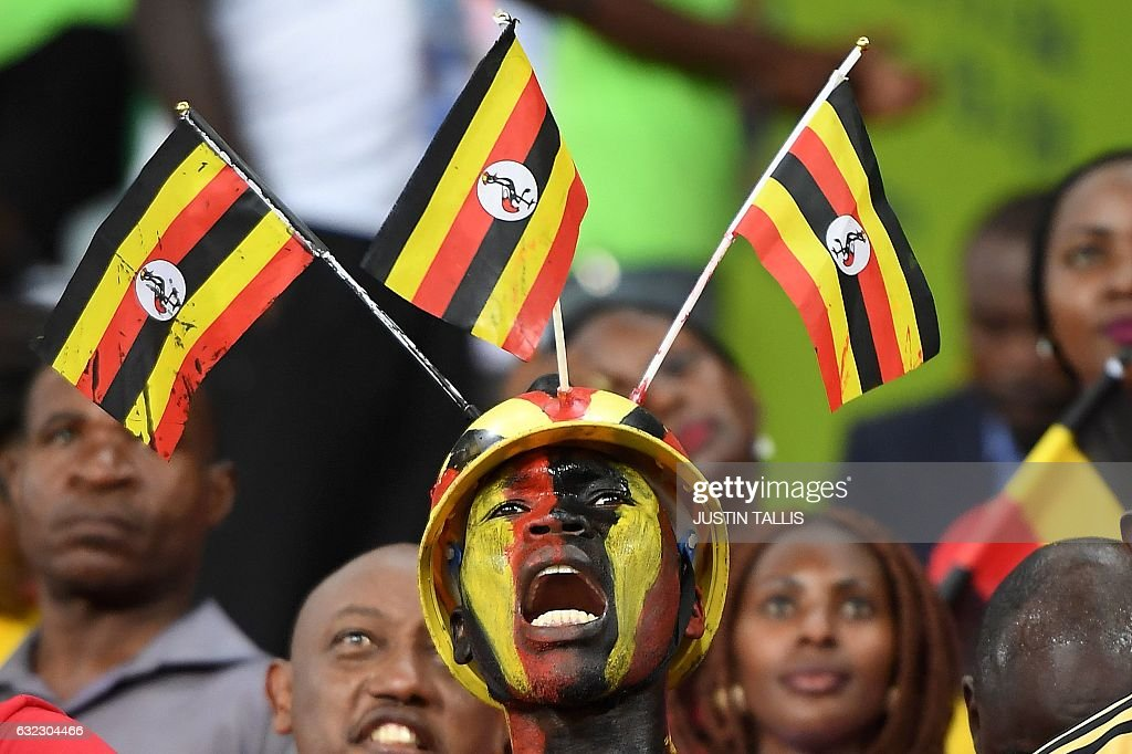 Uganda supporter cheers ahead of the 2017 Africa Cup of Nations group D football match between Egypt and Uganda in Port-Gentil on January 21, 2017. / AFP / Justin TALLIS