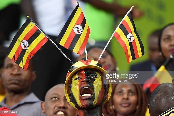 Uganda supporter cheers ahead of the 2017 Africa Cup of Nations group D football match between Egypt and Uganda in PortGentil on January 21 2017 /...