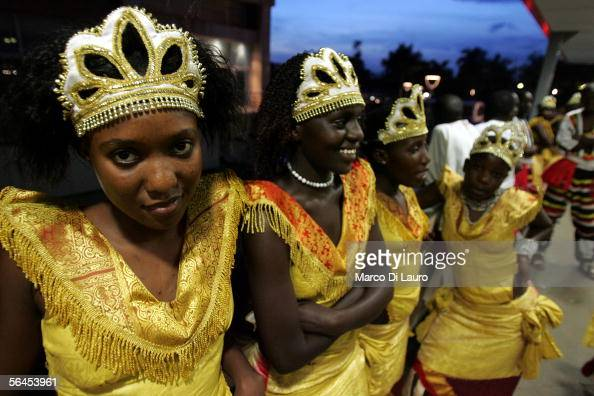 Ugandan girls dressed in a traditional costume attend a wedding on December 3 2005 in Kampala Uganda The Church of Uganda has been very active in...