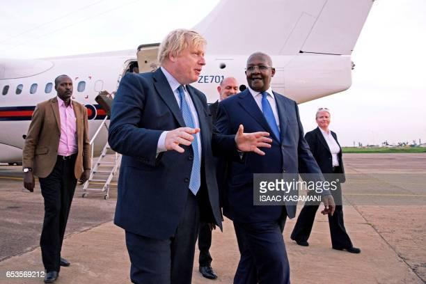 Ugandan Minister of Foreign Affairs Sam Kahamba Kutesa speaks with British Foreign Secretary Boris Johnson upon his arrival at the Entebbe...