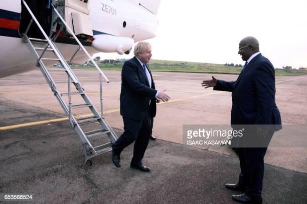 Ugandan Minister of Foreign Affairs Sam Kahamba Kutesa welcomes British Foreign Secretary Boris Johnson upon his arrival at the Entebbe International...