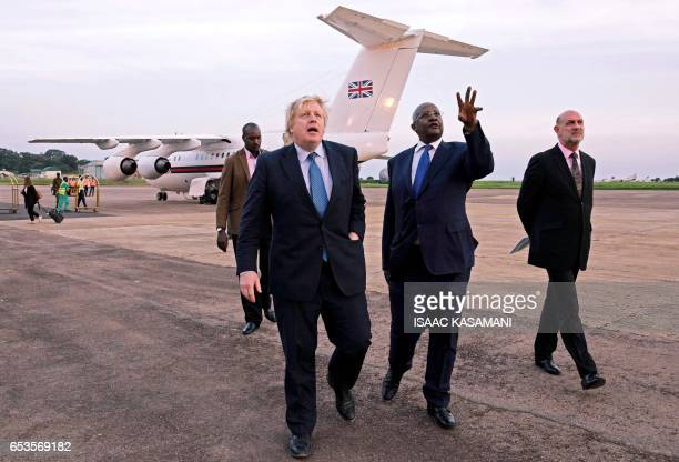 Ugandan Minister of Foreign Affairs Sam Kahamba Kutesa welcomes British Foreign Secretary Boris Johnson next to British High Commissioner to Uganda...